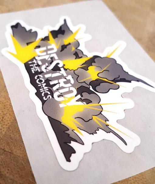 Exploding Destroy the Comics Logo – Die Cut Label Polypropylene Sticker