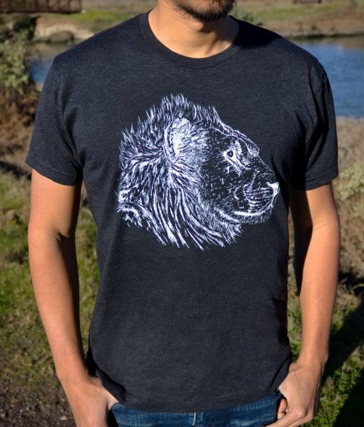 drawn lion on black t shirt modeled in nature setting