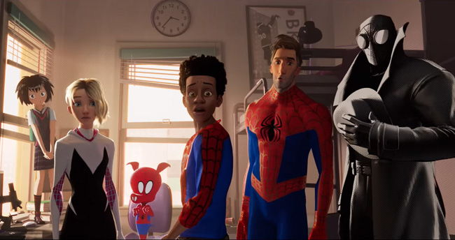 different spider-man versions standing around in miles room