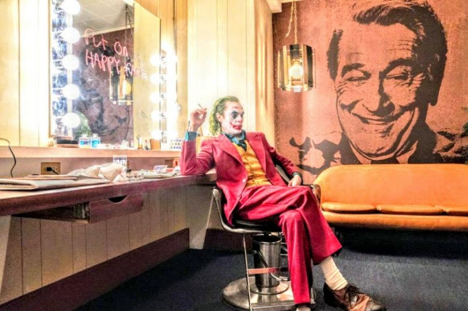 joker smokes a cigarette alone